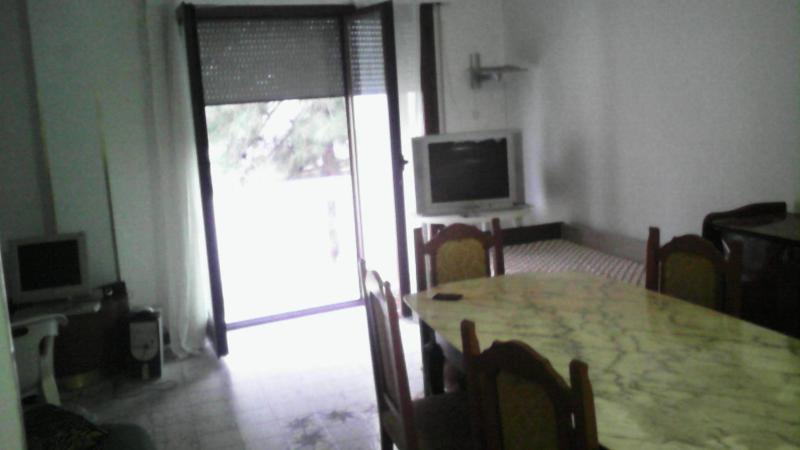living room with tv and air conditioning and mosquito net