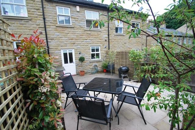 Rear garden with BBQ and seating