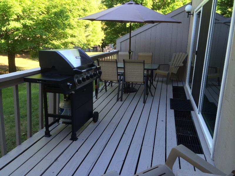 Large deck with new grill and large patio table. Great spot to enjoy the evening!