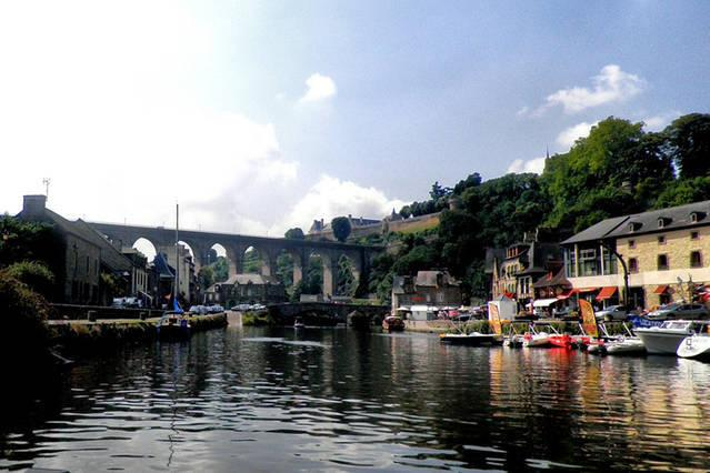 Port of Dinan, view from the river Rance - Riverside cafés, restaurants & boat trips available.