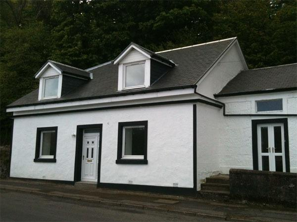 The 4 bedroom cottage looks out over Kames Bay and the hills of the Cowal Peninsula