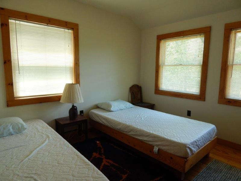 One of the two upstairs bedrooms.  Each has a king or two twin beds.
