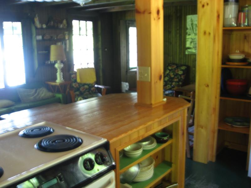 Kitchen looking over breakfast bar through living room to porch and lake