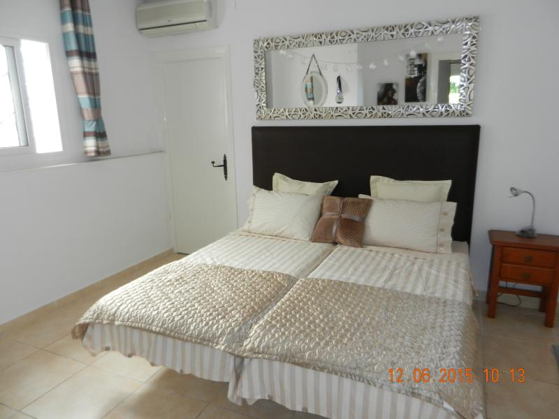 Second Bedroom With Twin Beds. Can be singles or double.
