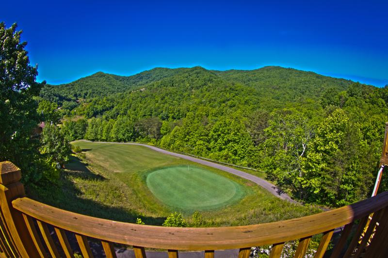 stunning mountain view overlooking golf course green