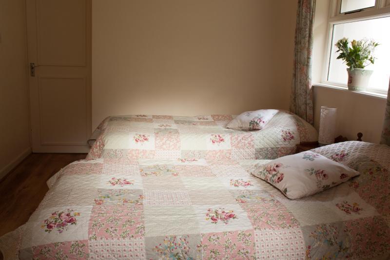 Restful bedroom with 2 single beds and en-suite shower room