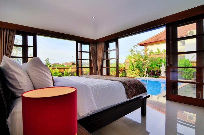 Master bedroom overlooking the pool and garden