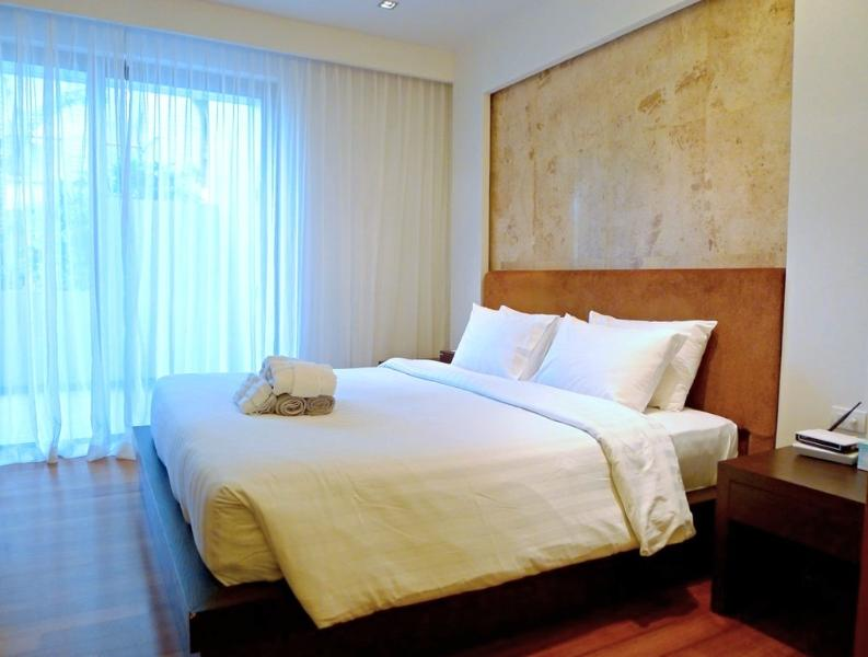 Master bedroom with a king size bed and a chest of drawers