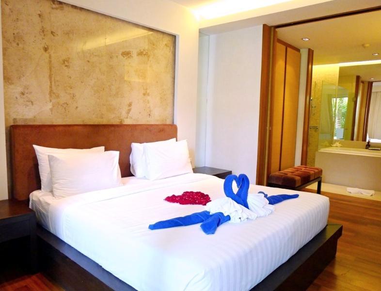 Master bedroom features large wardrobe and en-suite bathroom