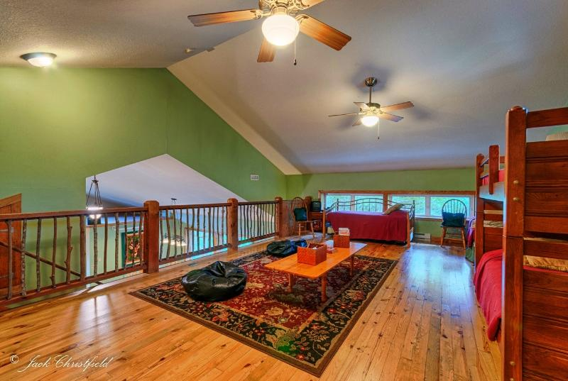 Loft with 2 pull-out trundles and bunk beds. Sleeps 6 with plenty of room to spare.