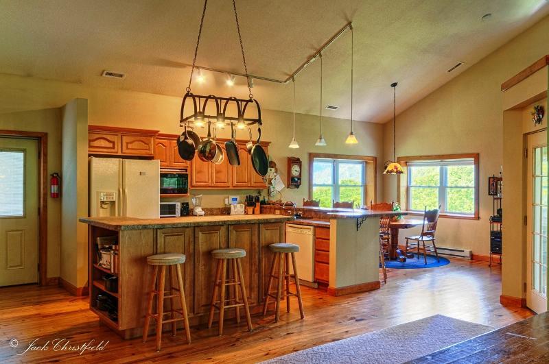 Kitchen, with breakfast nook beyond