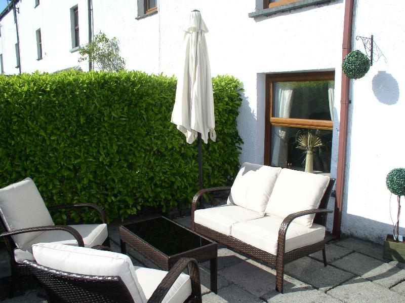 Relax and enjoy a glass of wine on the comfy funiture - in the South facing garden.