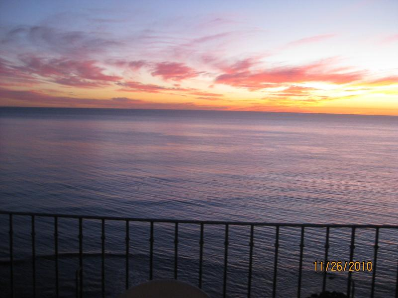 Toasting the Sunset is Tradition from your 8X24 ft. veranda Oceanfront!!