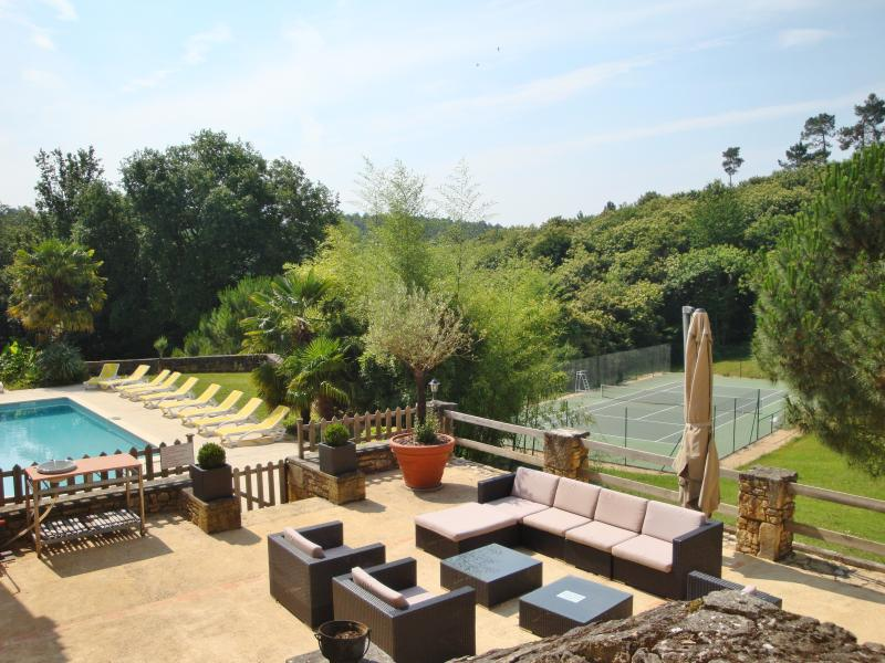Resin tennis of view, the heated swimming pool and terrace with garden furniture