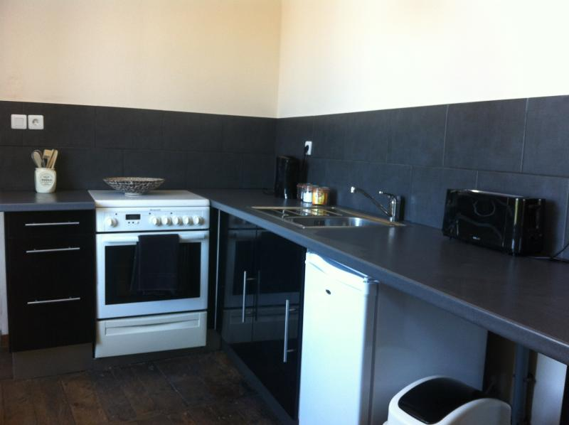 Recently refurbished kitchen with large window overlooking the square
