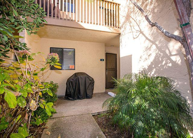 Entry to condo.  Front patio with a grill.