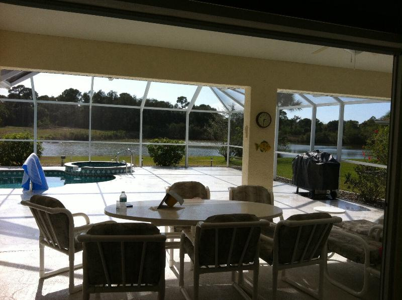 Outside dining area with sun beds and gas barbecue