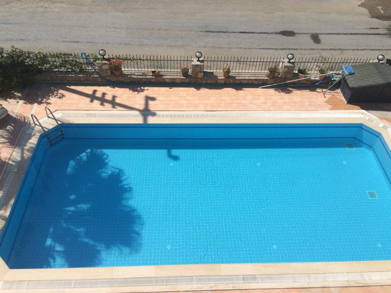 View down to swimming pool from master bedroom