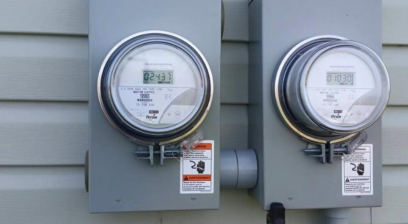 Twin electrical meters (generation on left, consumption on right).
