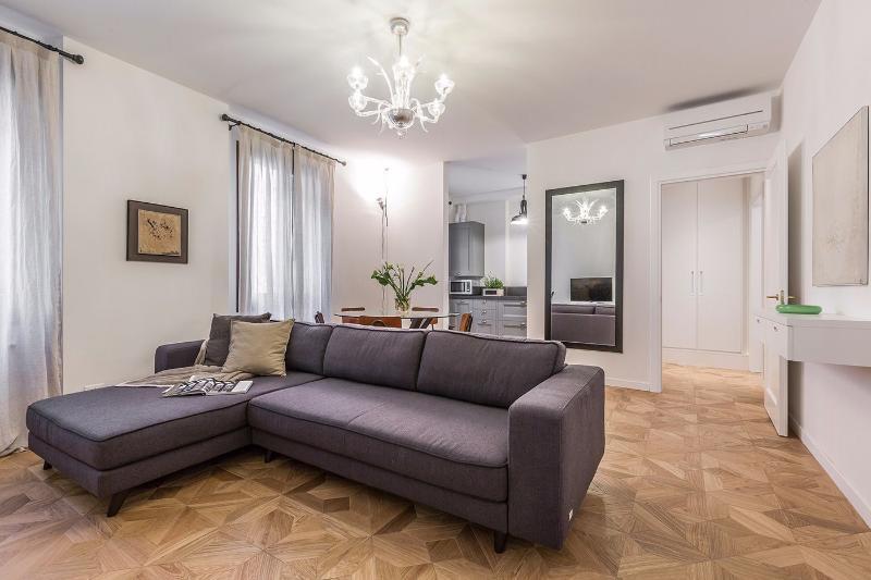 la sala de estar del apartamento Aida: estilo y comodidad garantizada