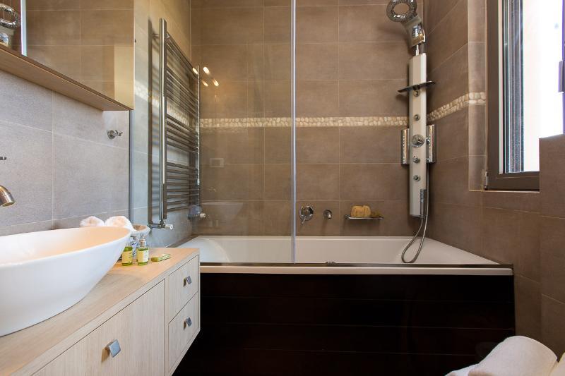 En suite bathroom with Jacuzzi bath on first floor