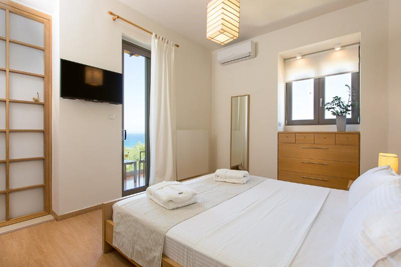 Main bedroom on 1st floor with private balcony and en suite bathroom