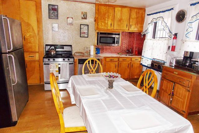 FULLY STOCKED KITCHEN WITH EAT IN DINING AREA EVERYTHING YOU NEED JUST LIKE HOME