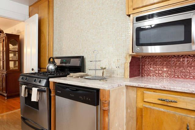 STAINLESS STEEL COPPER BACKSPLASH MARBLE COUNTERTOPS SIT DOWN HAVE A CUP OF COFFEE