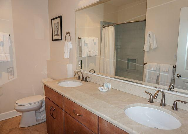 This hall bath services two bedrooms on the upper level.