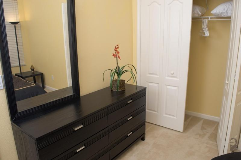 Bedroom 2 has a dresser and closet with plenty of room to store your things.
