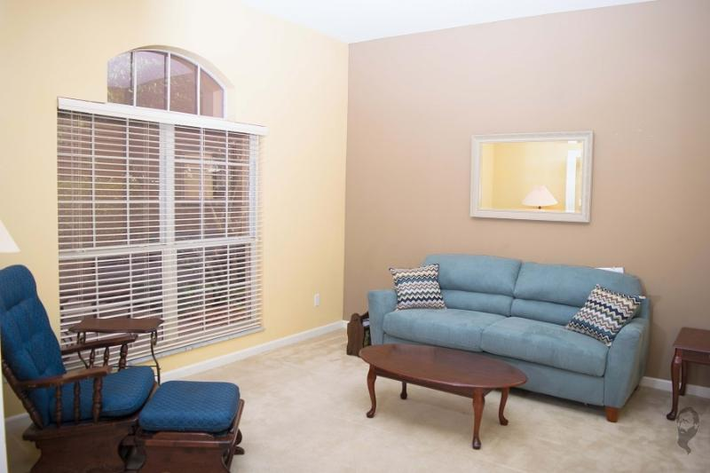 Living room has doors that open to make a quiet seating area or a private 5th bedroom.