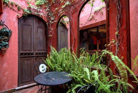 Another shot of the patio. Behind those elegant double doors...