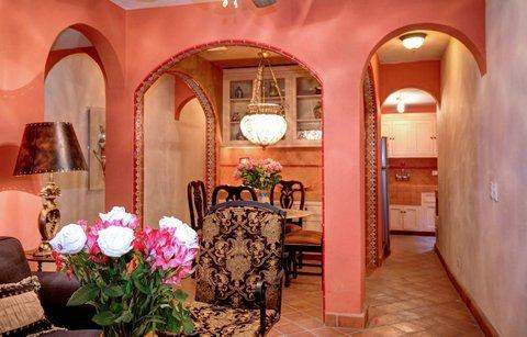 Nice dining room, set within tiled arched walls.