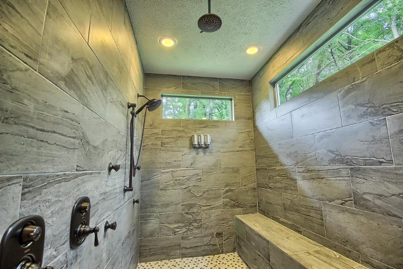 OWNER FAVORITE - Custom Shower with his and her body jets and 3 shower heads. 7 total