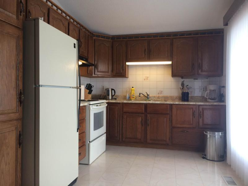 Kitchen is fully equipped with toaster, microwave, coffee maker, kettle pots/pans and dishwasher