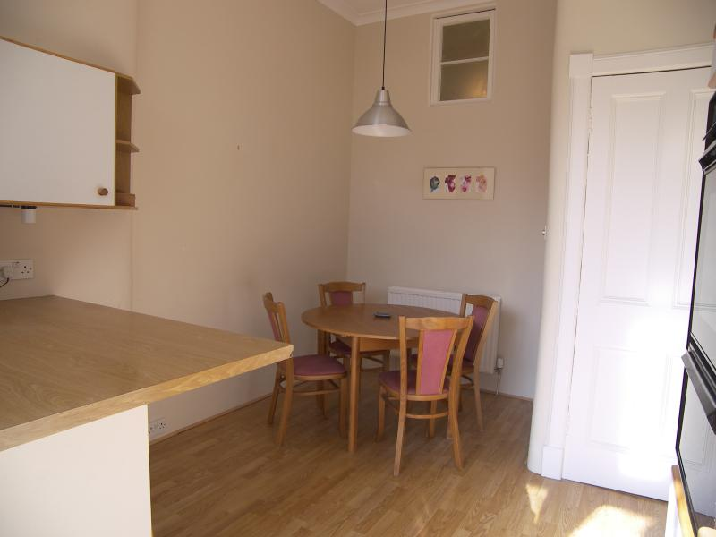 Dining recess with extending table and couple of extra chairs