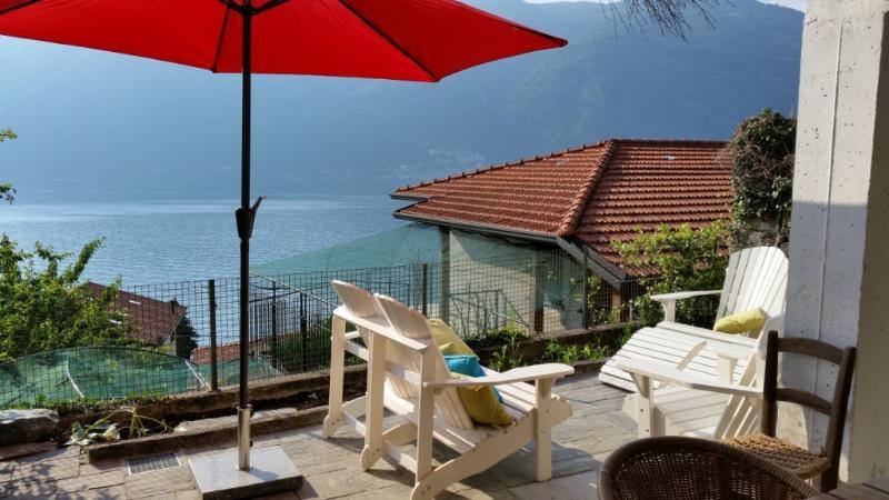 Comfortable loungeseats on terrace with astonishing view on Lake Como.
