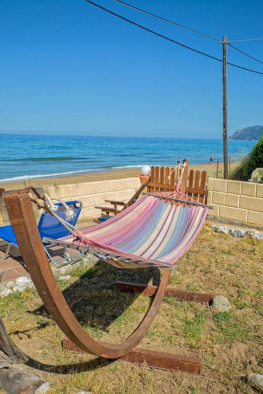 Relax by our other beachfront property a short stroll of 3 minutes  away