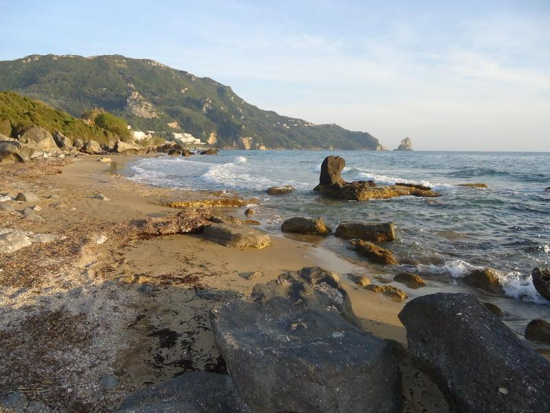 Agios Gordios secluded sandy bays a short walk way