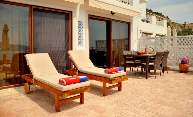 Sunbathing and dining on large private terrace with sun blinds