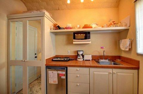 Kitchenette with microwave, 2 burner cooktop, refrigerator, coffee maker, and toaster