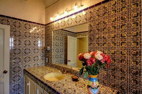 The lovely bathroom in the Frida studio is decorated with Mexican tiles. Also, LARGE vanity mirror!