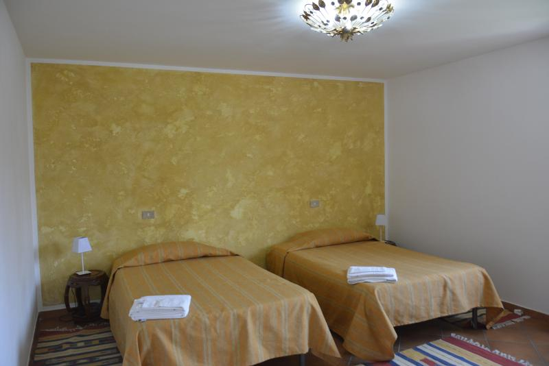Ensuite bedroom with double bed suitable for 2/3 persons. One of the 3  bathrooms is inside