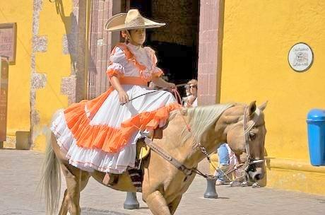 Señorita riding a horse in Centro streets. Just another day in stunning San Miguel!
