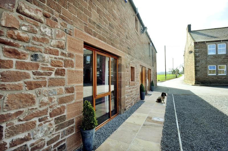The Old Grainstore at Red Hall Farm with feature window looking onto the farm yard