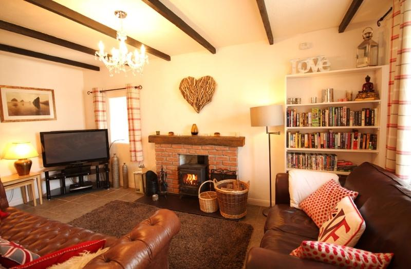 Living room with Large screen TV, DVD, Hi Fi system.