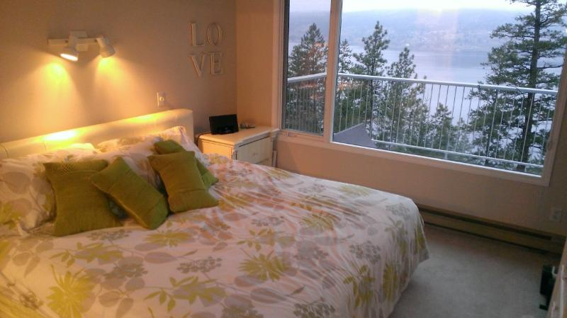 Wake up to a view in this comfy King bed.