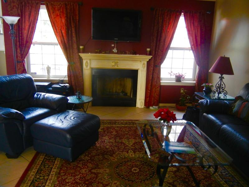 The family room has a wood burning fireplace and a flat screen t.v.