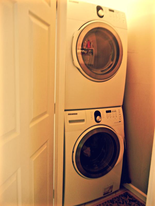 full sized washer and clothes dryer adjacent to the bedrooms