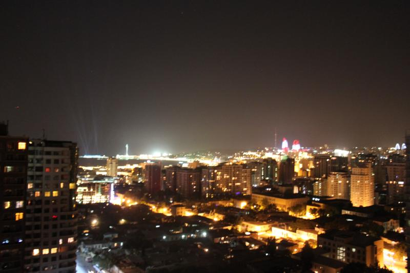 Panoramic city view from the balcony at night.
